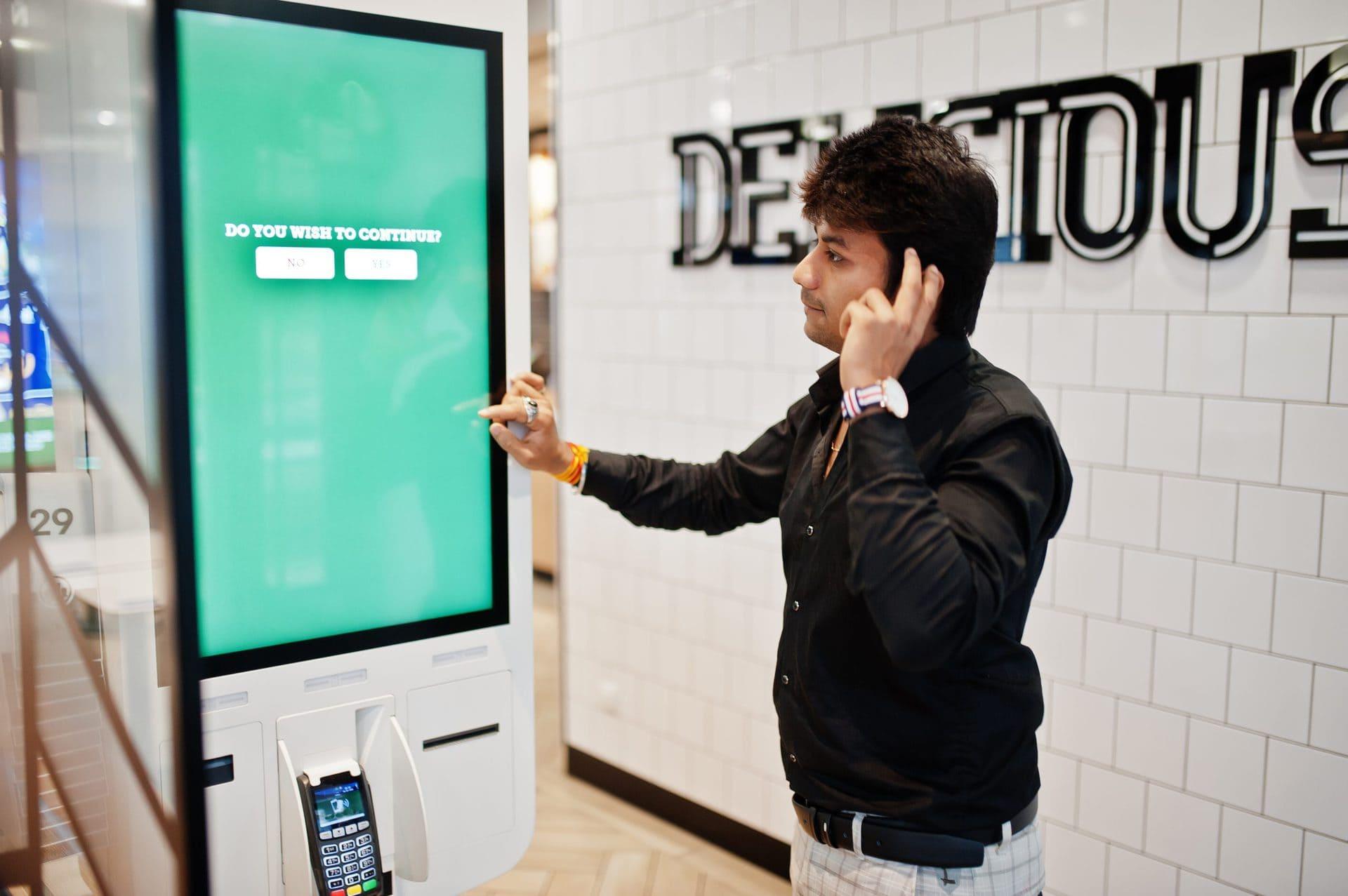 Self-service digital signage kiosk