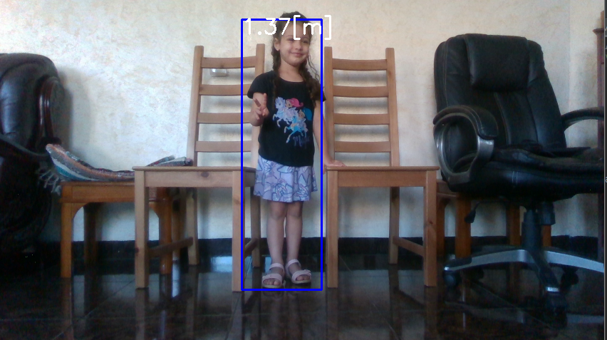 Image of a small child with a bounding box showing approximated height using TensorFlow and Intel RealSense Depth cameras