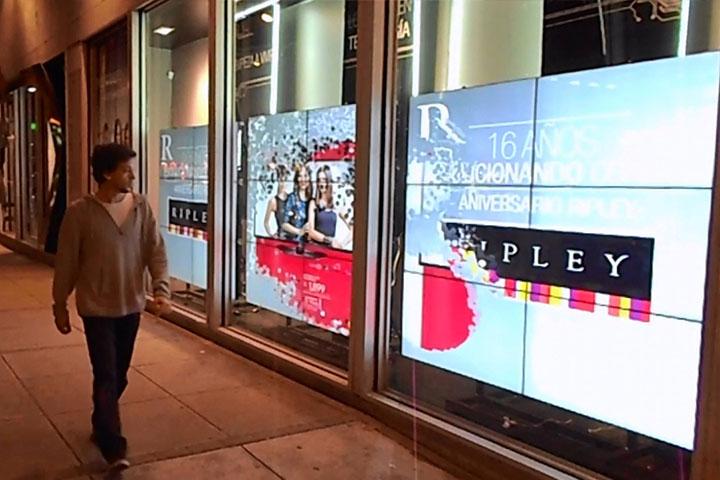 LUMOplay man walking in front of display